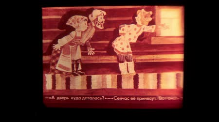 perforation : Old 8mm film strip of Russian folk fairy tale about Ivan the Fool slipping through an open projector gate. Film textures and effects