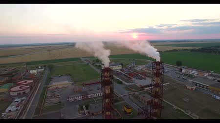 potash : 4K HD aerial flight over factory plant with smoking chimney pipes industrial view of inside yard territory of Belaruskali company producing and exporting potash fertilizers - ecology pollution concept