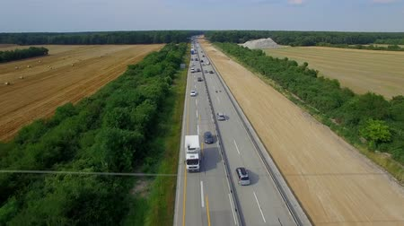 eko : Building constructing widening multilane highway road aerial top above view 4K HD. Cars and lorry trucks moving autobahn in Europe, Germany. Transportation cargo delivery logistics business vehicles