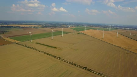 üretmek : 4K HD Wind turbine farm aerial video fly over ecological technologies power generating windmills produce clean renewable energy in countryside fields local road cars moving in distance Europe, Germany Stok Video
