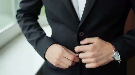 pansuman : Stylish man dressed in suit buttoning jacket close up. Male hands of confident gentleman adjust outfit preparing for formal evening. Image establishment leadership lifestyle masculinity style success