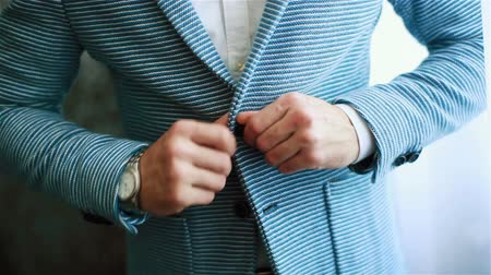 iyi giyimli : Buttoning jacket casual hands close up. Stylish well-dressed man arrange dressing in informal suit outfit preparing to go out. Expensive watch accessory. Macho luxury lifestyle golden youth style Stok Video