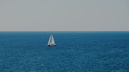 catamaran : A sailboat, yacht on the horizon in the Adriatic sea