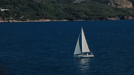 регата : A sailboat, yacht on the horizon in the Adriatic sea