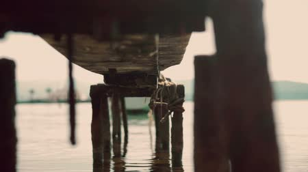 mírumilovnost : Old Pier Jetty on River with Water Sparkling in Bokeh as Beautiful Natural Background, 1920x1080 full HD footage.