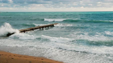 kumlu : Lonely pier in the Adriatic Sea big waves