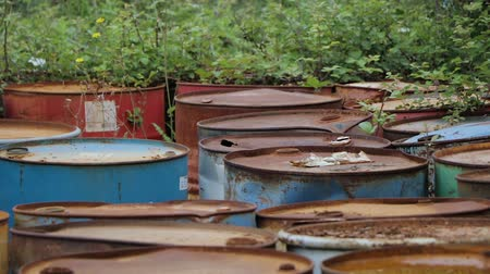 benzine : Old rusty barrels with oil products casks