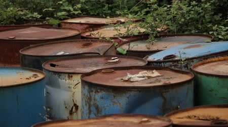 iva : Old rusty barrels with oil products casks