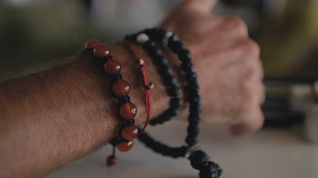 satysfakcja : Mans hand with bracelets for decoration