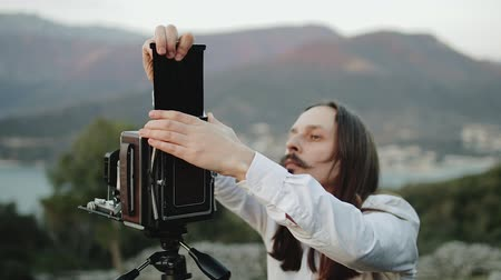 collectable : Photographer professional takes photos on a large format camera Stock Footage