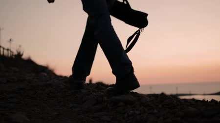 collectable : Photographer with a tripod out of the frame at sunset Stock Footage