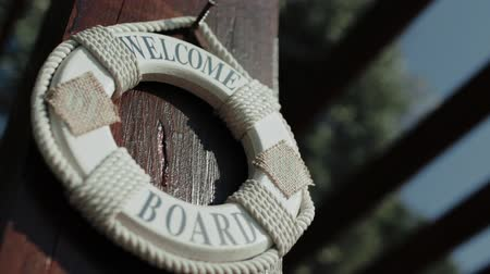 lifebuoy : Lifebuoy hanging on a wooden pole