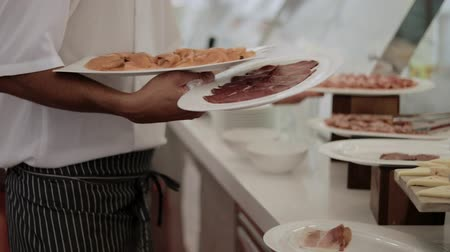 kutlama : The waiter holds plates with appetizers on which red fish, sausage, meat Stok Video