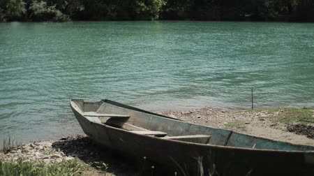 An old boat on the banks of a small river