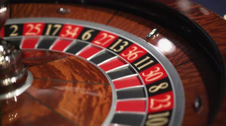 Roulette in the casino spins and white ball