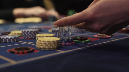 croupier : Gaming chips on the gaming table in the casino dolly is put on the chip