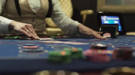 croupier : Dealer hands out cards at the gaming table Stock Footage