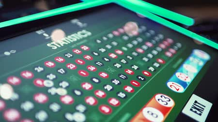 рулетка : Table with electronic roulette numbers in the casino Стоковые видеозаписи