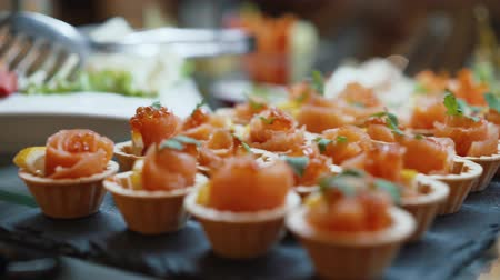 seafood dishes : Appetizing baskets of snack red fish Stock Footage