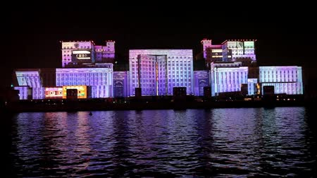projeksiyon : International Festival Circle of Light. Laser video mapping show on facade of the Ministry of Defense in Moscow, Russia