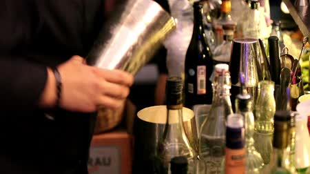 drink industry : Barman making drinks in bar