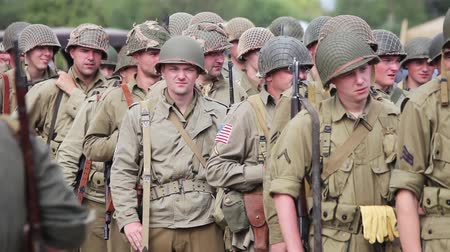 war field : Historical reconstruction of the Second World War. USA army soldiers Stock Footage