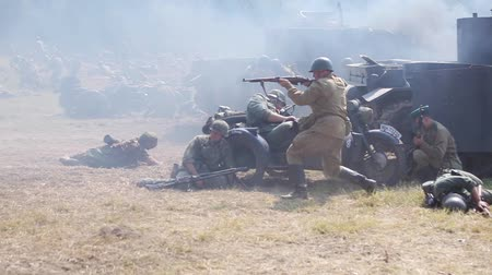 war field : Historical reconstruction of the Second World War. Soldiers on the battle field Stock Footage