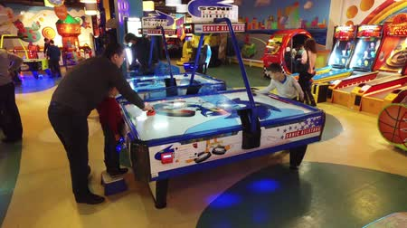 hurl : Teenagers playing air hockey game
