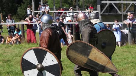 knightly : Participants on international historical reconstruction of medieval culture, knights fighting