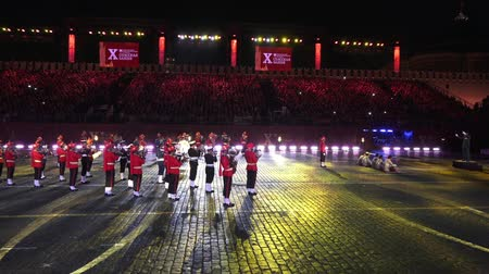 "participante : Performance of India Tri-Services Band on International Military Tattoo Music Festival ""Spasskaya Tower"" in Moscow, Russia"