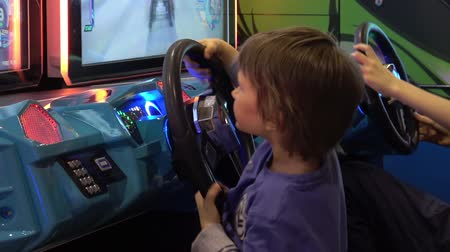 playstation : Boy playing auto simulator video arcade game
