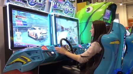 playstation : Girl playing auto simulator video arcade game