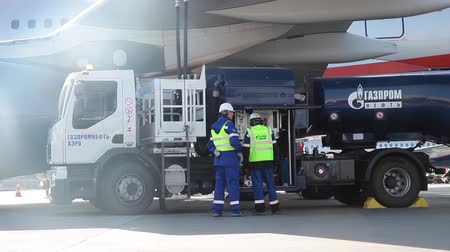 gazprom : Airport Gazprom company workers refueling the aircraft