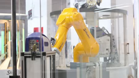 gyártó : Automatic robot arm on Staubli stand on Messe fair in Hannover, Germany