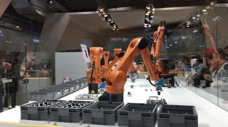 gyártó : Automation solutions of the future with robot arms on Kuka stand on Messe fair in Hannover, Germany Stock mozgókép