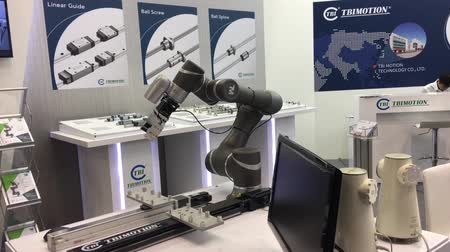 trade show : Automatic controlling machine in robot industry on TBI motion stand on Messe fair in Hannover, Germany Stock Footage