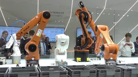 Automation solutions of the future with robot arms on Kuka stand on Messe fair in Hannover, Germany Wideo