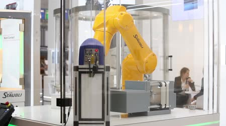 Automatic robot arm on Staubli stand on Messe fair in Hannover, Germany