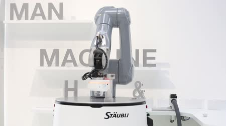 Automatic HelMo mobile robot on Staubli stand on Messe fair in Hannover, Germany