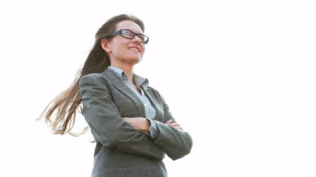 career success : Smiling businesswoman standing in a confident pose, wind blowing her hair Stock Footage