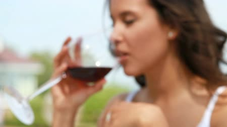 избирательный подход : Girl drinking red wine as aperitif before main course, selective focus