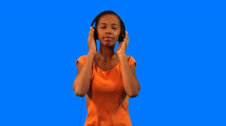 teen action : Beautiful young girl listening to music and dancing Stock Footage