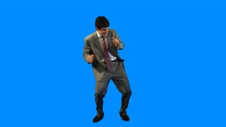 oblek : Young businessman in suit dancing over blue background Dostupné videozáznamy