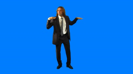танцоры : Happy businessman in suit dancing over blue background