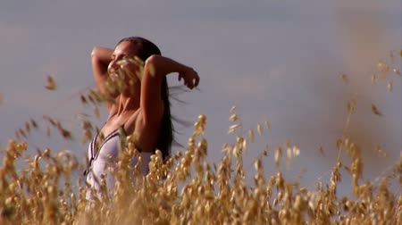 kırsal : Beautiful woman in wheat field Stok Video