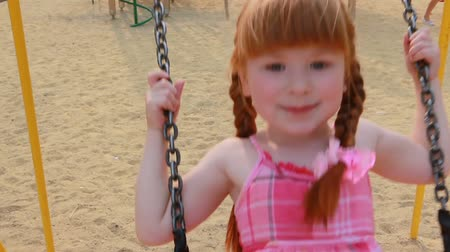 chains : Little girl on chain swings