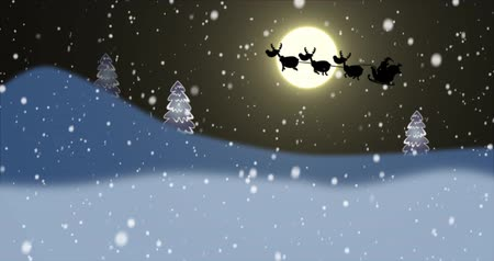 santa : Silhouette of Santa Claus and reindeers flying at night