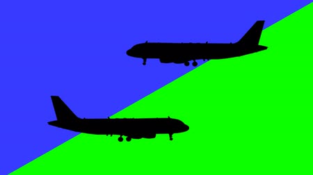 airplane engine : Two airplane flying in the opposite direction over against blue and green colors  Stock Footage
