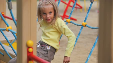 youngsters : Little girl sitting in playground net