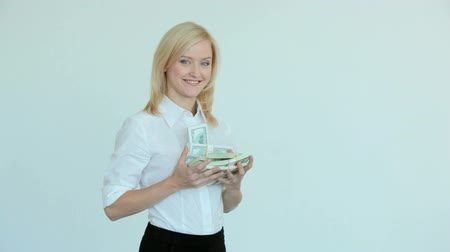 деловая женщина : Pretty blonde showing dollar bills in her hands